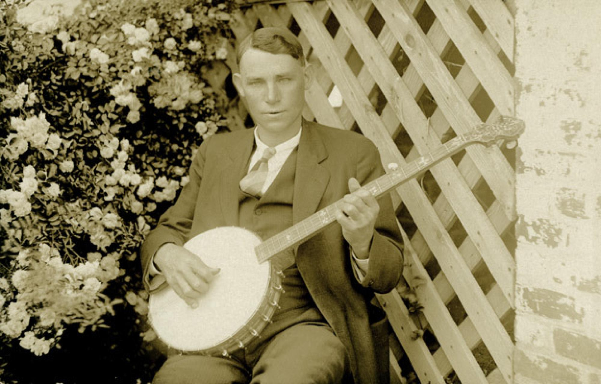 Charlie Poole posing with his banjo