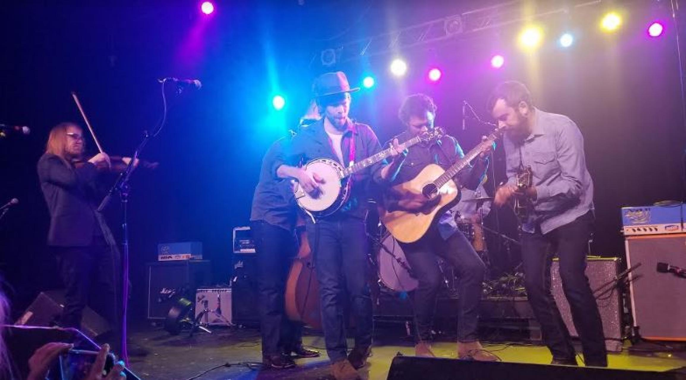 "Steep Canyon Rangers onstage at ""Cradle Turns 50"" on Jan. 4, 2020. From left: Nicky Sanders, Barrett Smith, Graham Sharp, Woody Platt and Mike Guggino 