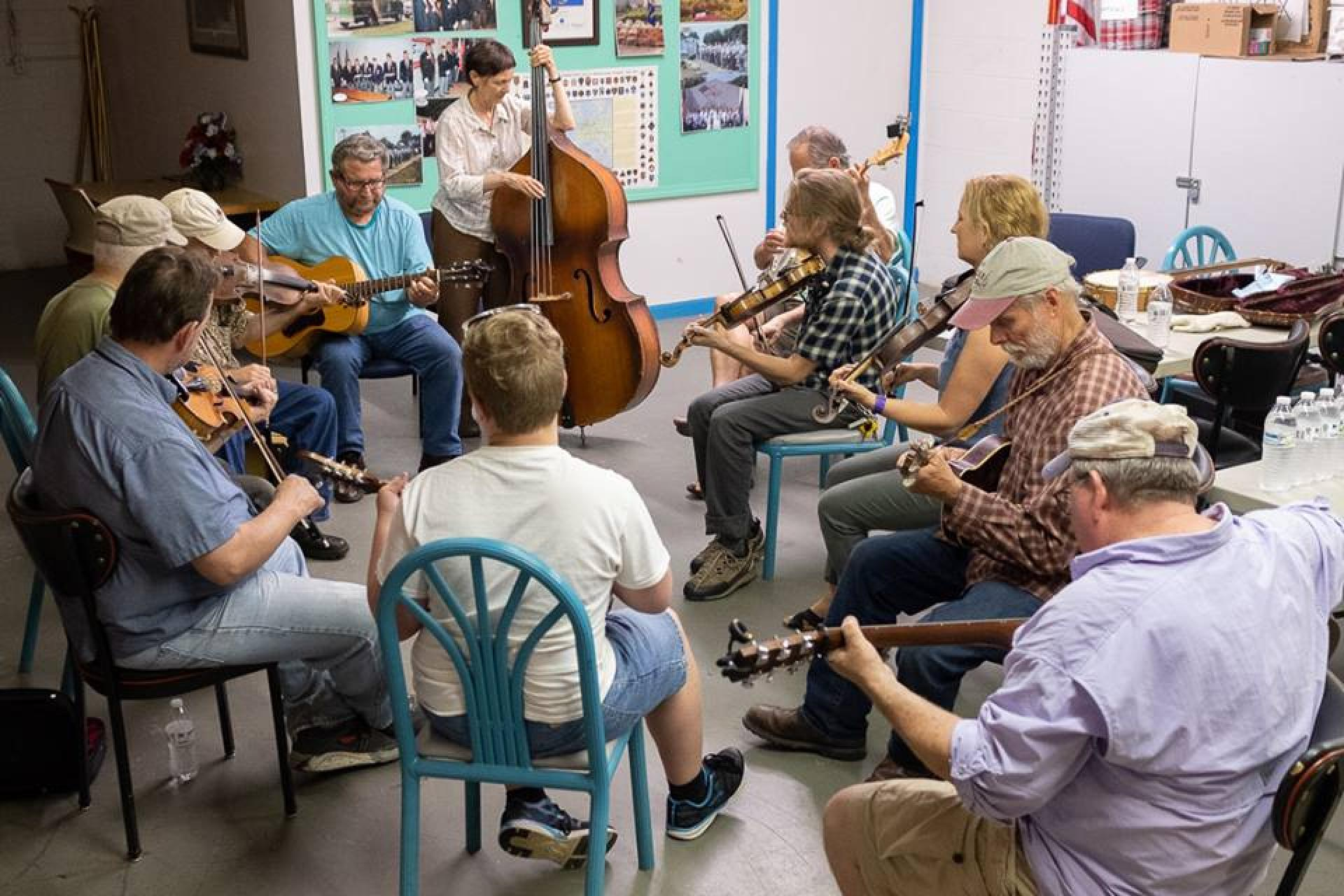 Musicians circle up at the Mount Airy Old Time Retreat