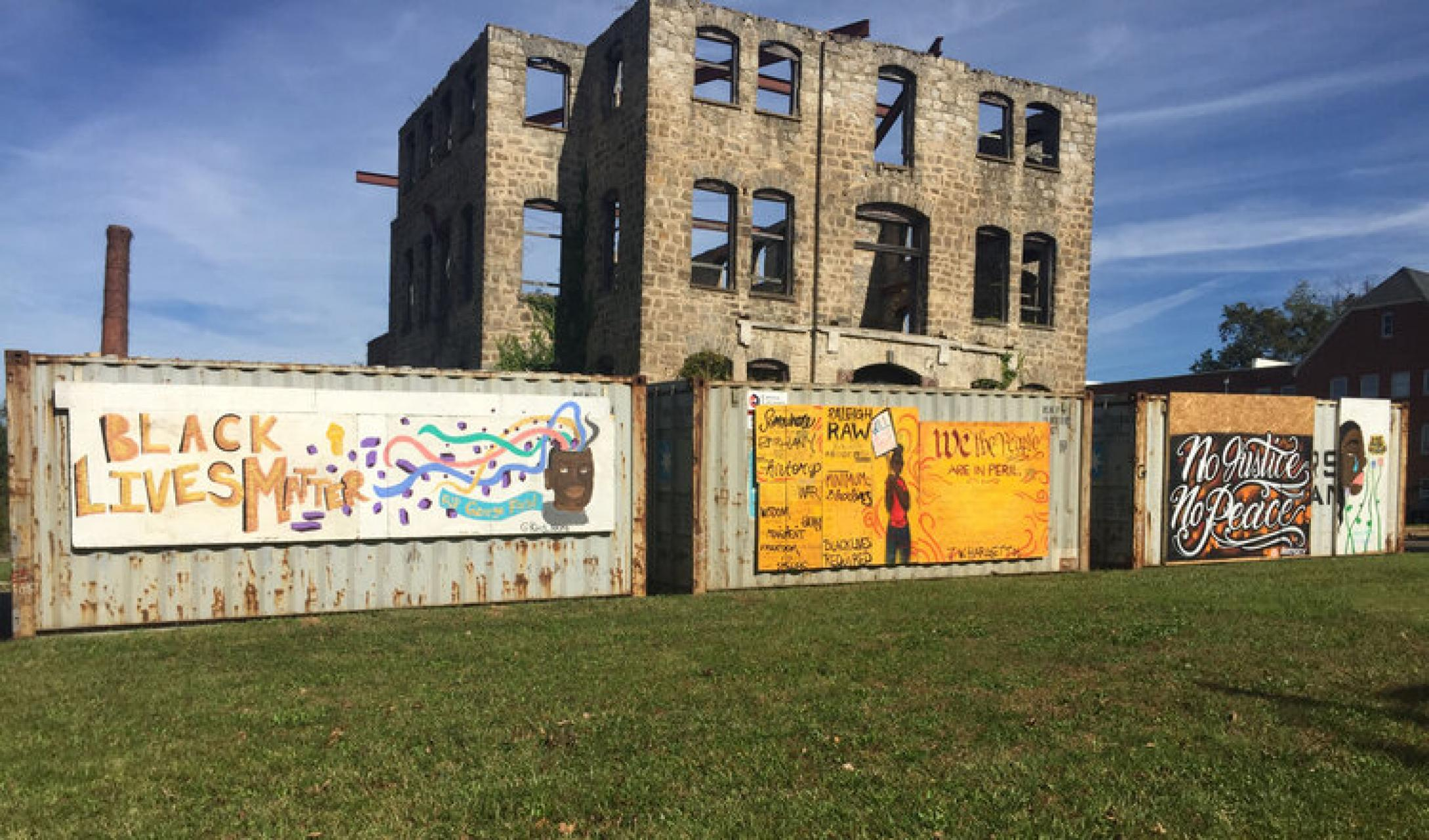"Artwork in ""A Space for Reflection,"" an outdoor installation at Saint Augustine's University and Shaw University. Pictured, left to right: artwork by Akira Dudley, Dare Coulter, Victor Knight and Akira Dudley at the Saint Agnes site on the campus of Saint Augustine's University."