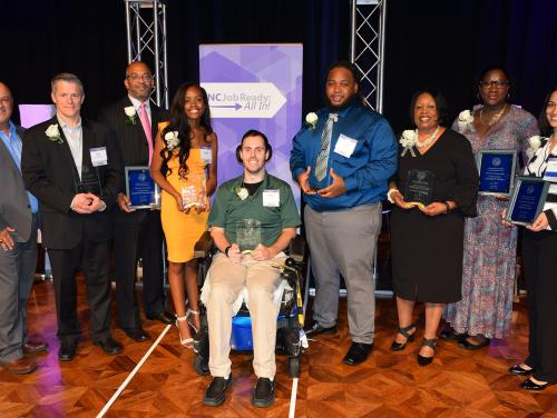 The Governor's NCWorks Awards of Distinction honorees included, from left, John Wilson and Andy MacLaren of BSH, Marvin Kelly of Goodwill Industries of the Southern Piedmont, Khamiah Alderman, Allen Shellenbarger, Lamonty Bullock, Patricia Chandler, Natasha Pender of Creating IT Futures and Danielle Frazier of Charlotte Works.