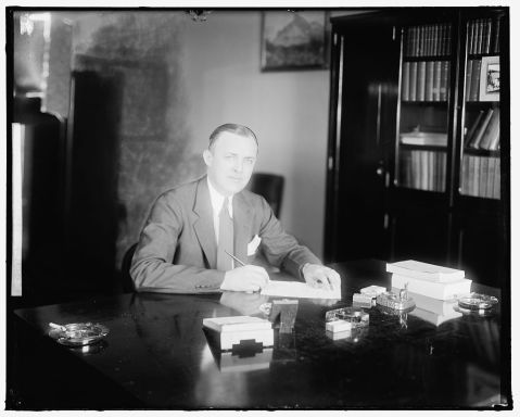 A picture of Harold Cooley at his desk, date unkown.