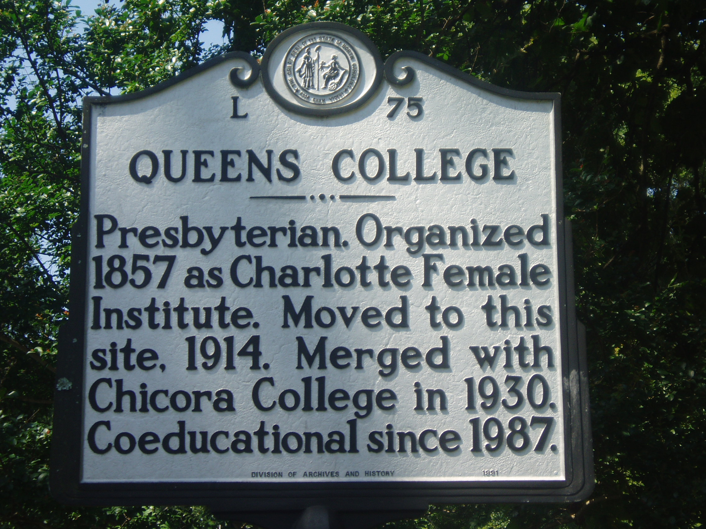 An NC Highway Historical Marker designating the site of Queen's College.