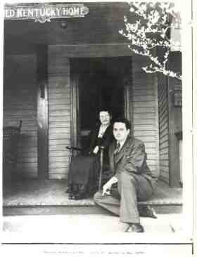 "Thomas Wolfe and his mother Julia pose on the front port of the ""Old Kentury Home."" Image from N.C. Historic Sites."