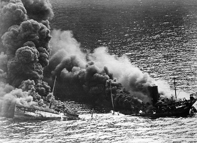 A tanker sinking off the Outer Banks after being hit by a U-boat. Image from the National Park Service.