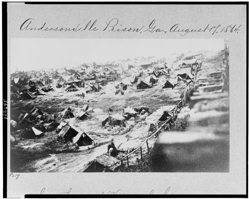 A view of Andersonville prisoners and tents in August 1864. Image from the Library of Congress.