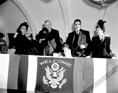 Governor R. Gregg Cherry and Governor W. Kerr Scott and their wives on reviewing stand during Scott's inauguration, January 1949. Image from the State Archives