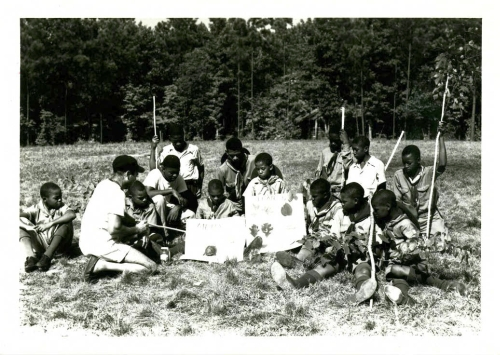 Boyscouts learning about native plants and animals at Crabtree Creek or Reedy Creek State Park, ca. 1940s to 1950s. North Carolina State Parks Collection, NC Digital Collections.