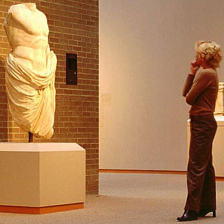 A Woman Takes in a Sculpture at the Art Museum in West Raleigh, North Carolina