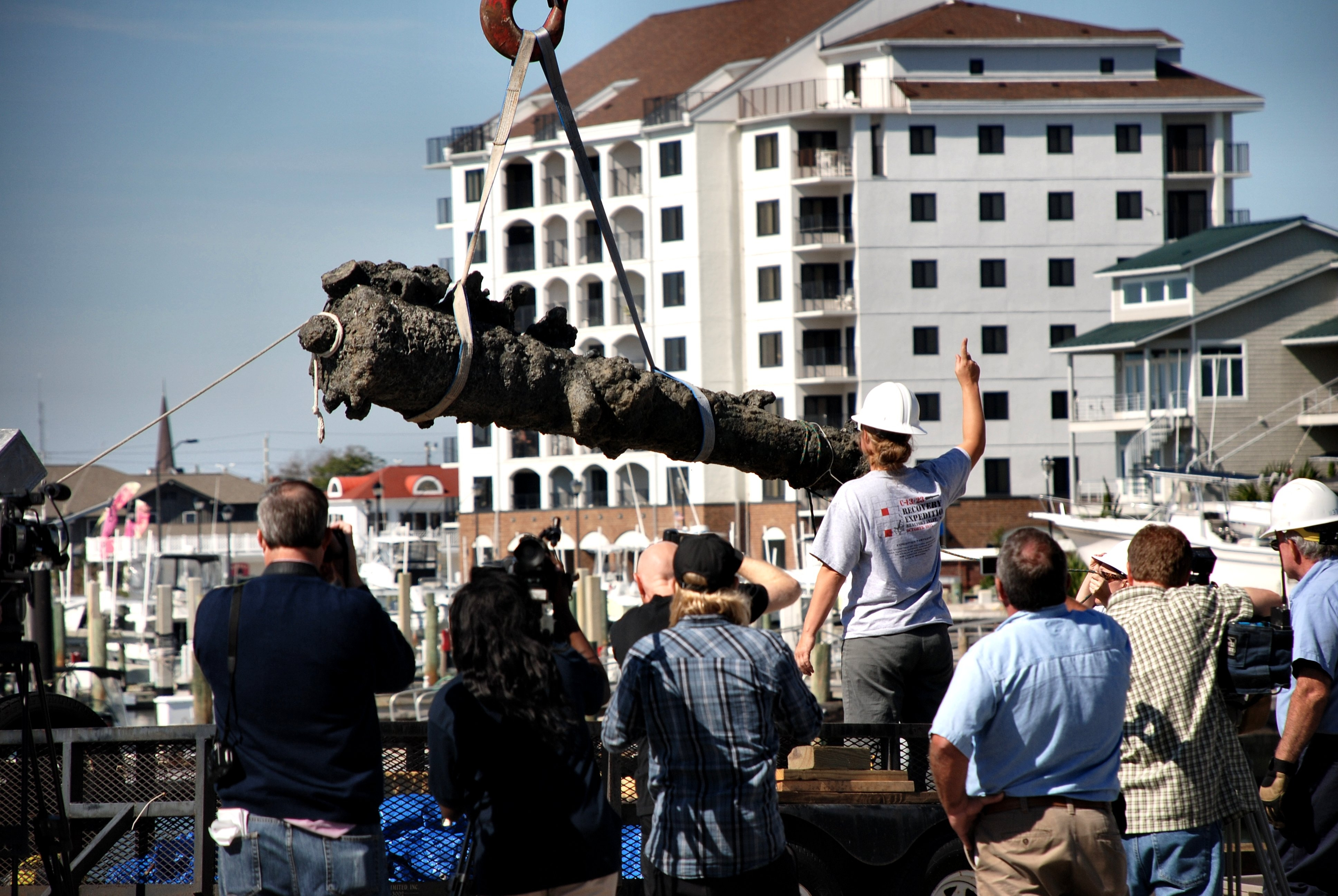 A cannon is offloaded onto land after being recovered from Blackbeard's Queen Anne's Revenge