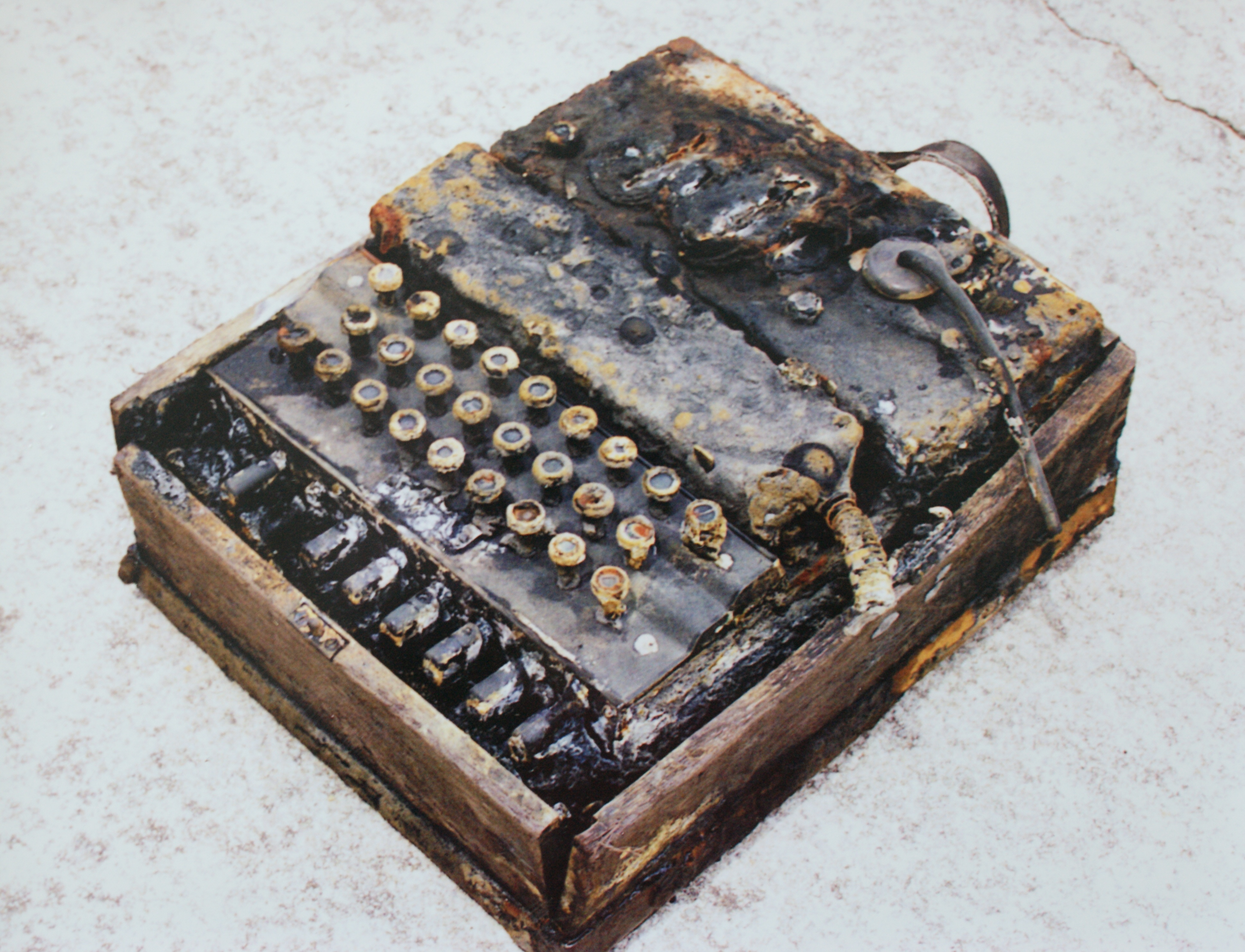 An Enigma machine, part of the collection of the Graveyard of the Atlantic Museum, early in the conservation process