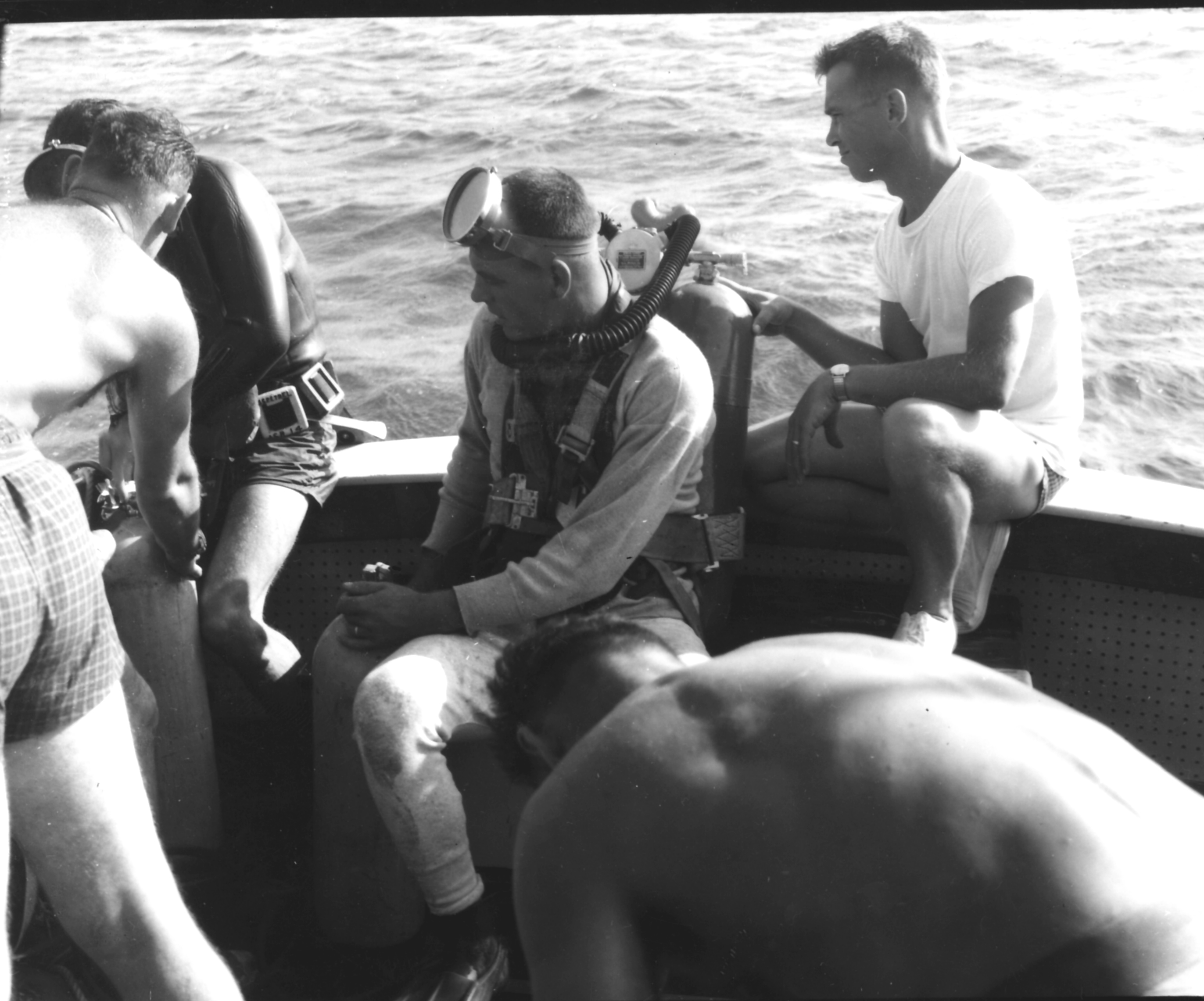 Navy divers prepare to explore the wreck in 1962