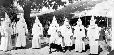 Klansmen in robes at tent meeting. Image taken from  the State Archives.