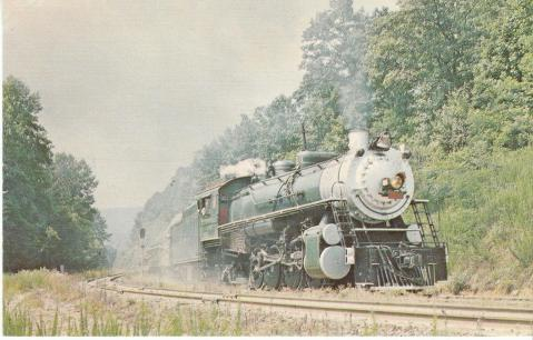 A circa postcard showing a train climbing the Saluda Grade. Image from N.C. State Historic Sites.