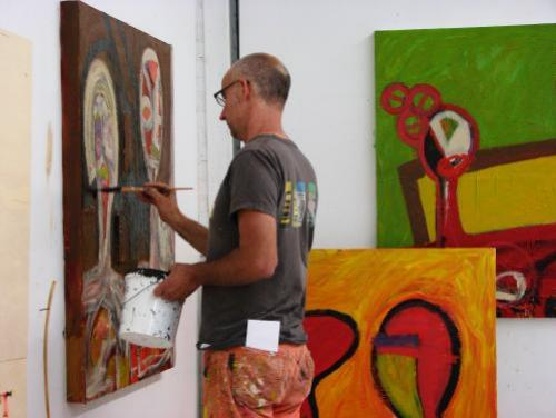 An Artist Paints in His Studio
