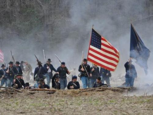 Re-enactors Carry the Union Flag into Battle at Bentonville Battlefield