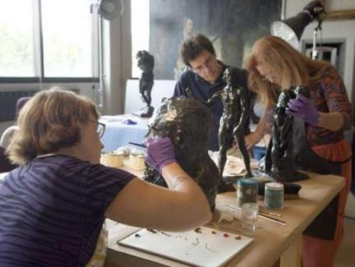 Conservators work at the N.C. Museum of Art