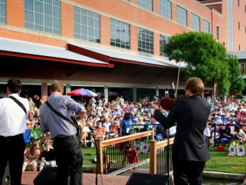 An outdoor concert at the American Tobacco Campus in Durham