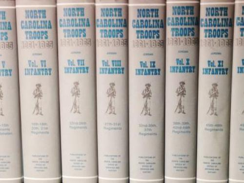 Several volumes of North Carolina Troops, 1861-1865: A Roster stacked on a shelf