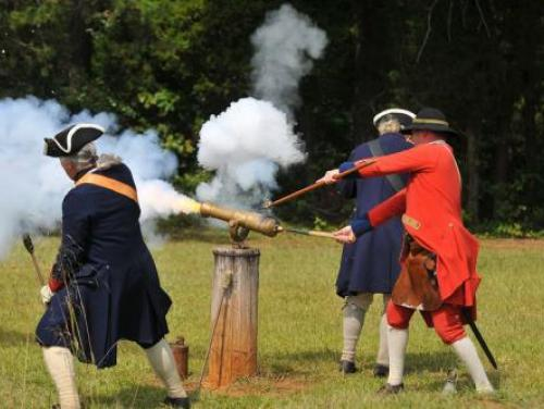 Interpreters Fire a Cannon at Fort Dobbs