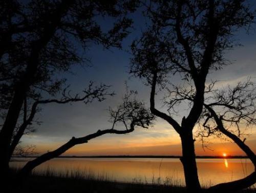 The sun sets over Carolina Beach