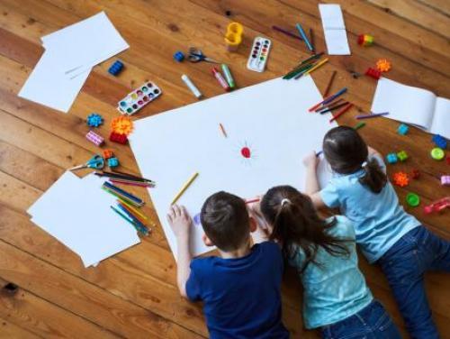 Children drawing on floor