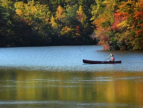 A canoe glides across a lake at Hanging Rock State Park