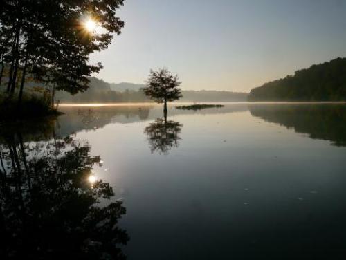 The sun rises over Jordan Lake
