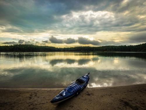 A kayak on the shore of Lake James