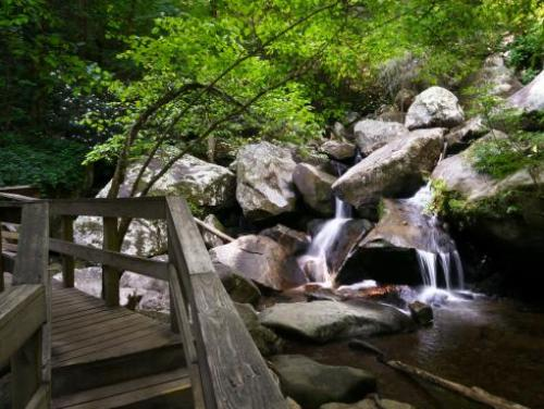 A waterfall trickles into the Jacob Fork River at South Mountains State Park
