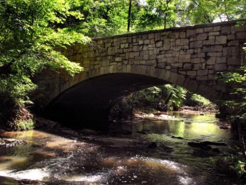 A bridge spanning one of the many creeks at William B. Umstead State Park