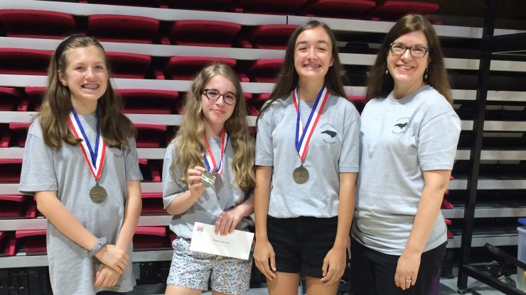 Grace Amantea, Catherine Boyette, Laura Shelton, and teacher Anne Boyette won a prize for group performance at the National History Day Competition