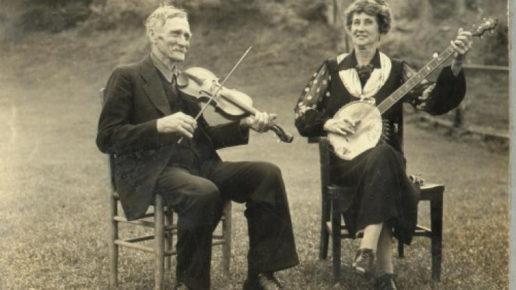 """Aunt Samantha"" Bumgarner plays a banjo with a man at the Asheville Mountain Music Festival, circa August 1938."