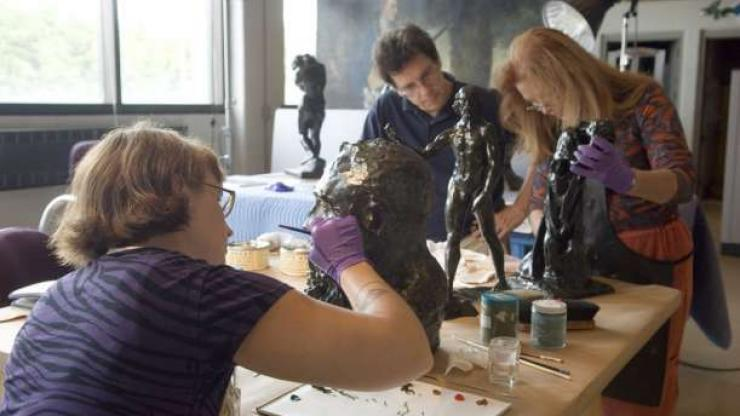 Conservators work in the conservation lab at the N.C. Museum of Art