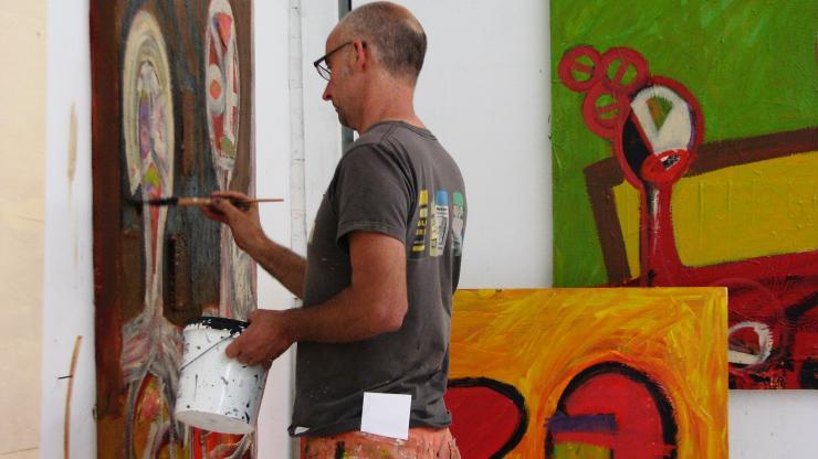 An Artist Paints in His Studio