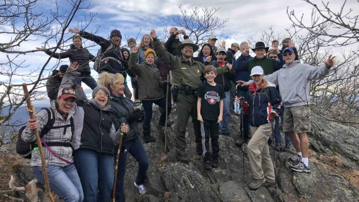 Hikers join Superintendent Joe Shimel on Luther Rock during a first day hike at Mount Jefferson State Natural Area