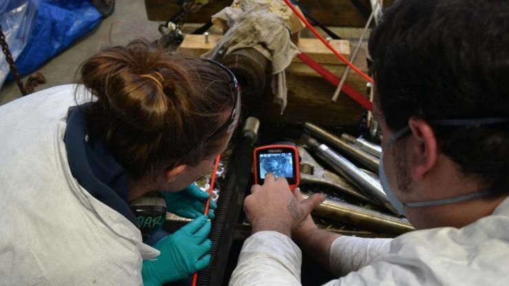Conservators work on preserving a cannon at the Queen Anne's Revenge lab