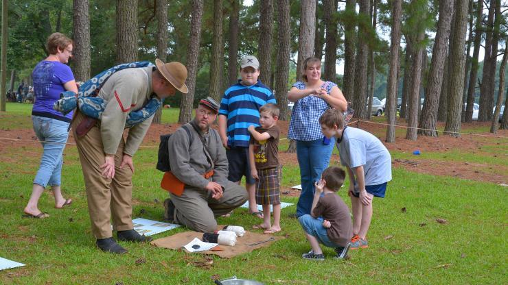 Civil War re-enactors explain artillery rounds to kids