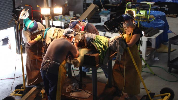 Conservators clean a cannon recovered from the wreck of Blackbeard's flagship