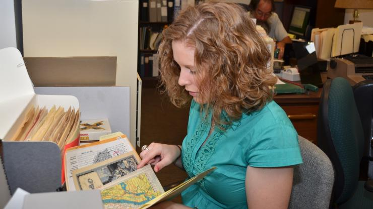 Intern Brynn Hoffman works with the Elmer Gibson Collection in the State Archives
