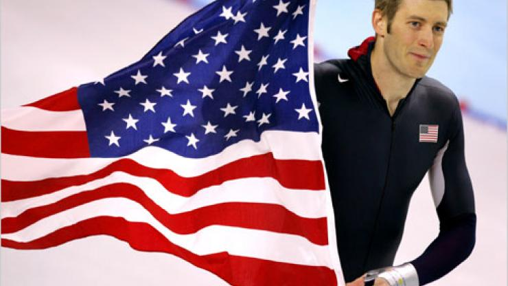 Joey Cheek waving the American flag at the 2006 Turin Olympics.