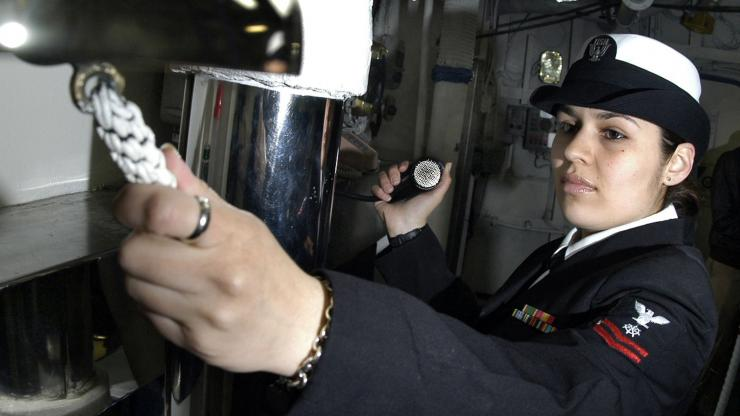 A quartermaster aboard the USS Kitty Hawk chimes the ship's bell