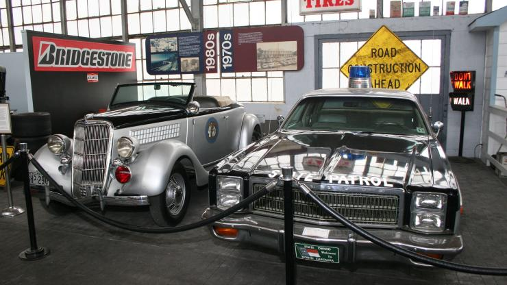 "The ""Bumper to Bumper"" exhibit at the North Carolina Transportation Museum features a variety of antique automobiles, including the state Highway Patrol car"