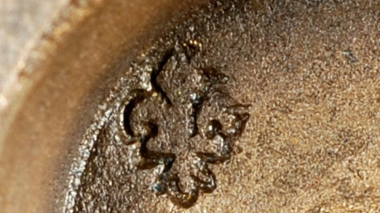 Up close on the fleur de lis patter on the nesting cups recovered from the wreck of Blackbeard's flagship