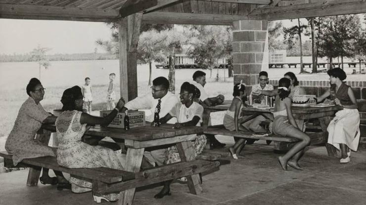An African American family picnicking under a picnic shelter, circa 1950.