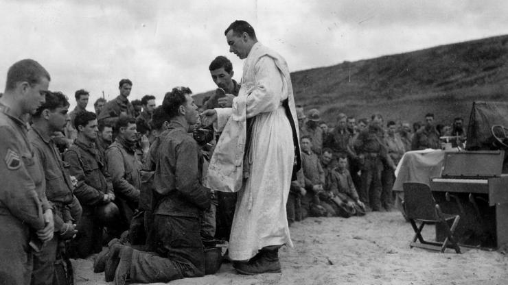 Father John McGovern gives mass in France during World War II. Image from the U.S. Army.