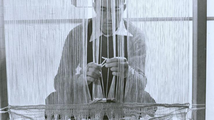 Student Don Page at a loom, doing work for a Black Mountain College weaving class