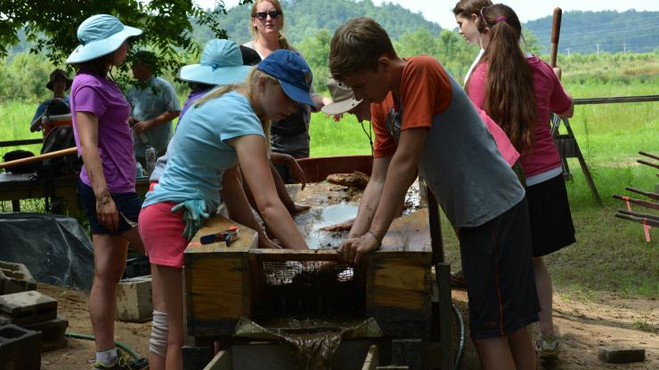 Students help archaeologists excavate the site of Fort San Juan near Morganton