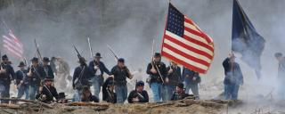 Re-enactors Carry the Union Flag into Battle at Bentonville Battlefield