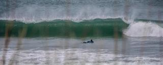 Surfer paddling out to the waves